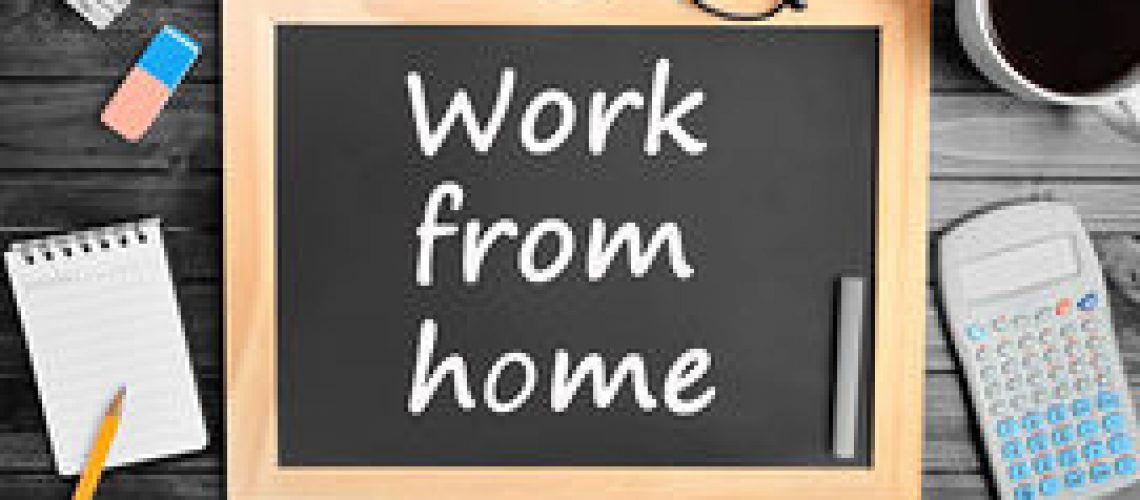 the-words-work-from-home-on-chalkboard-closeup-stock-photo_csp40017344